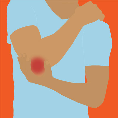 benefits of sports massage: a client holding a sore elbow