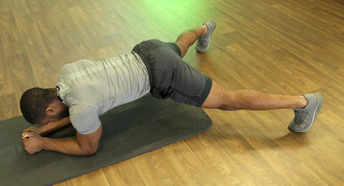 how to do a plank jack image