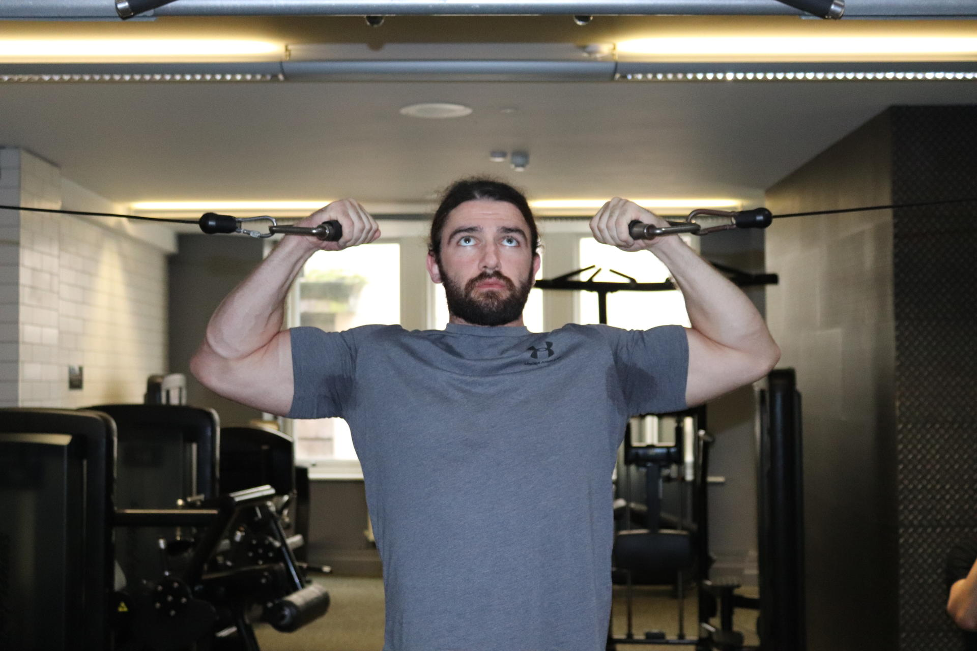 standing bicep cable curl behind